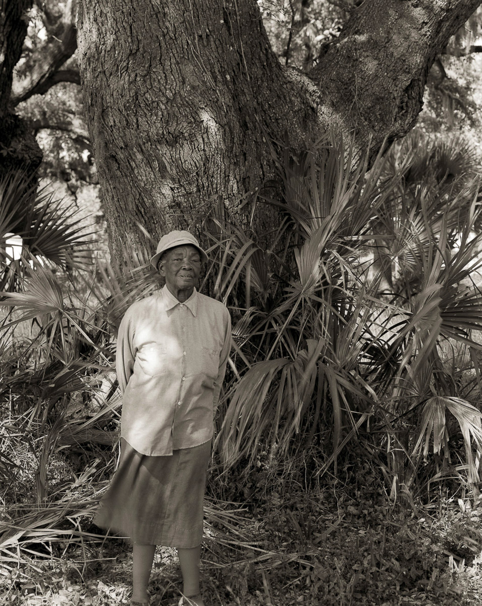 MISS ELOISE AND OAK TREE PLANTED BY HER GRANDFATHER, A SLAVE ON POINT OF PINES PLANTATION, EDISTO ISLAND, SC